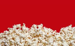 Popcorn viewed from above on red background with copy space. Load of popcorn viewed from above on red background with copy space Royalty Free Stock Photos