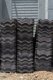Load of roofing tiles at a residential home construction site. Royalty Free Stock Photos