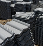 Load of roofing tiles at a residential home construction site. Royalty Free Stock Photography