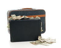 Loaded. A zippered suitcase next to a briefcase that's overflowing with money Royalty Free Stock Photography