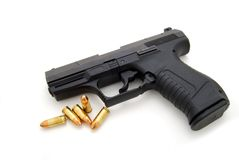 Loaded. A hand gun with bullets Stock Photos