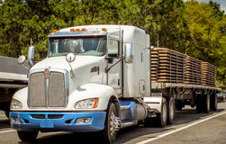 A Loaded American Truck. A large American truck, used for transporting heavy goods interstate, across America Stock Photos