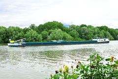 Loaded barge floating in the canal. Royalty Free Stock Photo