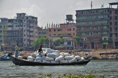 Loaded boat on a river in Dhaka royalty free stock photo