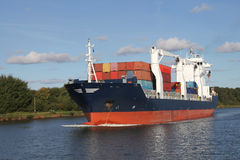 Loaded container ship on Kiel Canal Royalty Free Stock Image