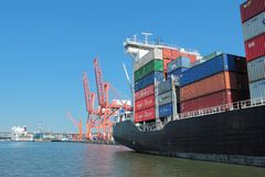 Loaded container ship in port of Gdynia Stock Image
