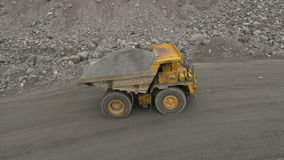 A loaded dump truck. Aerial shot of a loaded dump truck stock video footage