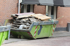 Loaded dumpster near construction site Stock Photography