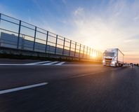 Loaded European truck on motorway in sunset. Loaded European truck on motorway in beautiful sunset light. On the road transportation and cargo stock photos
