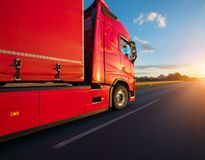 Loaded European truck on motorway in sunset. Loaded European truck on motorway in beautiful sunset light. On the road transportation and cargo royalty free stock images