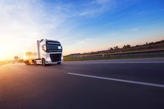 Loaded European truck on motorway in sunset. Loaded European truck on motorway in beautiful sunset light. On the road transportation and cargo royalty free stock photography