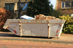 Loaded garbage dumpster Stock Photography