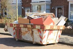 Loaded garbage dumpster. Loaded dumpster near a construction site, a home renovation or maintenance Stock Photos
