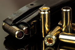 The loaded holder for the gun and cartridges Stock Photo