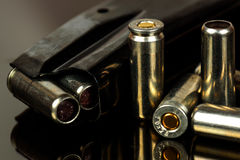 The loaded holder for the gun and cartridges Royalty Free Stock Photo