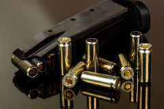 The loaded holder for the gun and cartridges against Stock Photo
