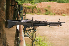 Loaded Machine Gun. A M-60 machine gun, loaded with live ammunition, on a firing range in Vietnam stock photo