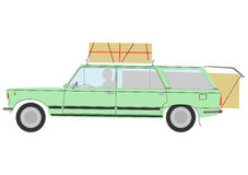 Loaded retro station wagon car. Royalty Free Stock Image