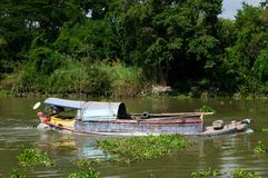 Loaded river boat in Thailand Stock Photos