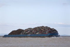 Loaded Scrap Metal Recycling Barge Royalty Free Stock Photo