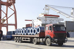 A loaded truck in harbor. A truck is loaded with reels of steel plate in harbor in Shanghai in China Stock Photography