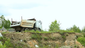 Loaded Truck in the quarry. Loaded Truck in the granite quarry goes to the top stock video footage