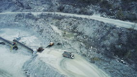 A loaded truck with a stone in a stone quarry. Aero survey stock video footage