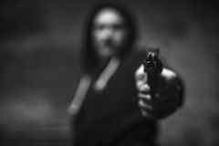 Loaded wicked criminal pulling a gun on somebody Royalty Free Stock Photos