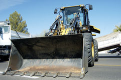 Loader 1. A front end loader staged for a new construction project in a suburban area Royalty Free Stock Image