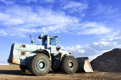 Loader. A front end loader at the work site Royalty Free Stock Images