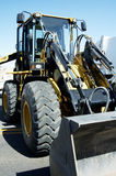 Loader 3. A front end loader staged for a new construction project in a suburban area Royalty Free Stock Photos