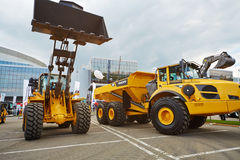 Loader and articulated hauler VOLVO. MOSCOW - MAY 29: Loader and articulated hauler VOLVO at 13th International Specialized Exhibition of Construction Equipment Royalty Free Stock Photos