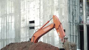 Loader backhoe, excavator digging a trench. Clip. Work of excavating machine on building construction site. Excavator stock footage