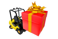 Loader with a box as a gift by a holiday Royalty Free Stock Photography