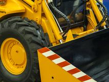 Loader with bucket. Yellow wheel loader with rubber wheels and bucket stock photos