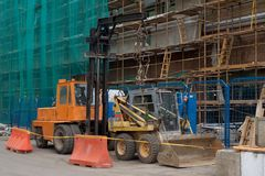 A loader and the bulldozer. Building technics: a loader and the bulldozer Stock Image