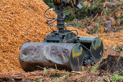 Loader Clamshell Grab Bucket attached onto excavator arm Royalty Free Stock Image