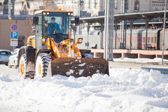 Loader cleaning road from snow Royalty Free Stock Photo