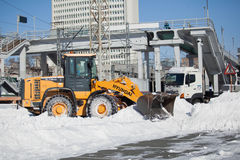 Loader cleaning road from snow Royalty Free Stock Images