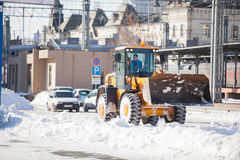 Loader cleaning road from snow Stock Photography