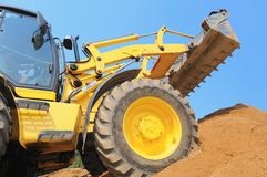Loader at construction work Stock Photos