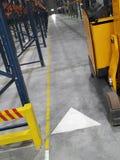 Loader in the empty storehouse. Modern loader in the empty storehouse Stock Images