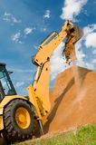 Loader excavation construction. Backhoe loader excavator equipment at sand construction works Stock Photography