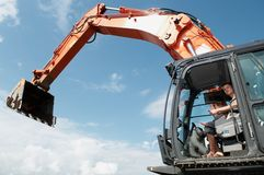 Loader excavator at construction Stock Photos