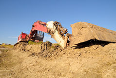 Loader excavator on construction site. Pink and white loader excavator on construction site Royalty Free Stock Image