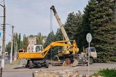 Loader excavator and mobile crane Stock Image