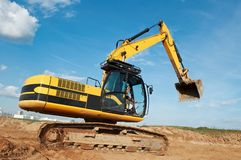 Loader excavator moving in a quarry stock photos