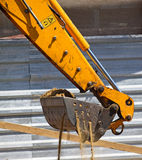 Loader of the excavator. At the road construction Royalty Free Stock Photos