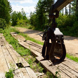 Loader Grapple on Log Deck Stock Image
