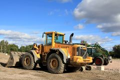 Loader and grapple tractor at construction site stock photography
